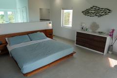 King size platform bed in the upper level bedroom - Gracehaven Villa
